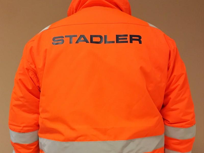 Personalizzazione abbigliamento da lavoro, Applicazione termoadesiva logo